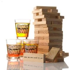 """Tipsy Tower comes with 4 shot glasses and 60 bricks to build a 20-storey tower. These aren't standard bricks though, oh no...Fifteen of the bricks are drinking - instruction blocks, stating that you must """"Make a rule"""", """"Reverse"""" the order of the game or """"Take a drink"""". They might also demand that the player to your right takes a drink or two. Keeping this tower upright and stable is going to become steadily more difficult as the night progresses! No cheating though: water is unacceptable!"""