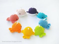 Crochet amigurumi whales, rainbow of colors