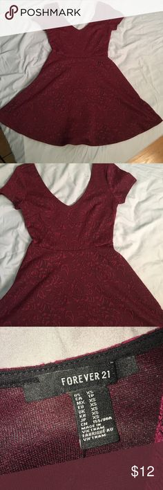 Forever 21 Red Floral Dress A floral skater dress from forever 21. The red is like a wine red. Dress is in excellent condition and was only worn twice! Forever 21 Dresses Mini