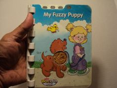 My Fuzzy Puppy.  from Fisher Price Power Touch Baby. Pages are all in plastic. In paperback format. Used and in good condition. From Mattel, Inc. Released in 2004. Made in China.Clean. Without notes & highlighting in all its pages. Readable.