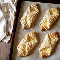 """""""These cream cheese danishes are easy to assemble and so satisfying. The layers of flaky buttery puff pastry topped with lemon-scented cream cheese filling and a simple icing make for an impressive and indulgent snack or treat."""" - Annalise from Completely Delicious"""