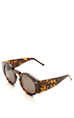 These retro inspired oversize tortoise shell sunglasses from Opening Ceremony feature a round lens and wide arms.AcetateImportedPlease note: This item is Final Sale.