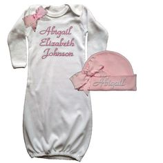 A delicate pink bow adorns this soft baby gown. Personalized with her name makes this a special keepsake outfit. Matching pink hat with a pink ruffled bow complete this beautiful, coming home from the hospital outfit.
