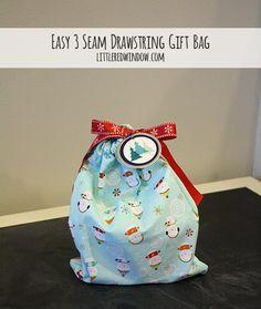 Raid your fabric stash and make this Easy 3 Seam Drawstring Gift Bag Tutorial via littleredwindow.com