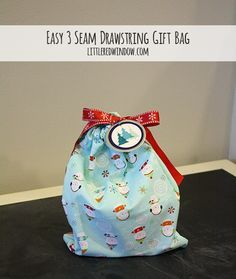Raid your fabric stash and make this Easy 3 Seam Drawstring Gift Bag Tutorial via littleredwindow.com