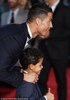 Ronaldo poses with his young son Cristiano Ronaldo Jr(right)
