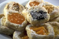 European Kolacky     1 cup  butter or margarine, softened  1 package  (8 oz) cream cheese, softened  1 tablespoon  milk  1 tablespoon  sugar  1 1⁄2 cup  all-purpose flour  1    egg yolk  1⁄2 teaspoon  baking powder  1 can  Solo or 1 jar Baker filling (any flavor)       confectioners sugar