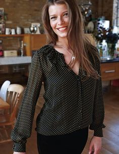 Black and white polka dotted blouse