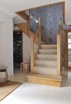 A centrally-positioned mixed modern glass and natural oak staircase with a half-landing turn and gallery landing. Light coloured carpet, wooden feature step and beautiful purple patterned wallpaper. Bespoke Staircases, Wooden Staircases, Modern Staircase, Staircase Design, Staircase Ideas, Loft Staircase, Contemporary Stairs, Staircase Makeover, Railing Design