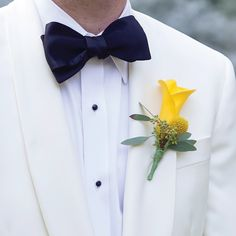 Yellow calla lily boutonniere // photo by: Arden Prucha Jenkins // Bridal Bouquet: Central Market