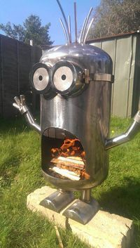 Jaw-Dropping Lawn Decorations for the Yard That Has Everything This fire-breathing minion fire pit is sure to light up your back yard.This fire-breathing minion fire pit is sure to light up your back yard. Metal Fire Pit, Diy Fire Pit, Fire Pits, Welding Art Projects, Metal Projects, Minion Fire Pit, Deco Cool, Bois Diy, Fire Pit Designs