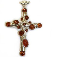 Crafted Baltic Amber and Silver Cross. $59.99, via Etsy.