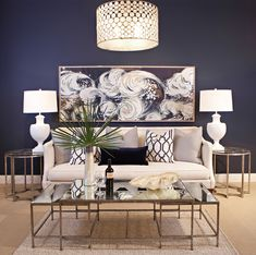 Love the navy feature wall, taupe lounge, cushions and light fitting. I just painted my living room but this picture makes me want to redo everything. LOVE everything in this picture!!!!!