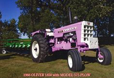 """Purple Oliver - For those who don't know the story behind the purple Olivers - The way I heard it was that it was a promotion to sell Oliver plows, they painted several tractors purple and traveled around to different shows and dealerships.  The slogan was something like """"It doesn't matter the color of the tractor it should be pulling an Oliver plow""""."""