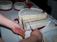 """Here are some step-by-step photos of how to cut a wedding cake. This method can be used on round or square cakes and coordinates with the Wilton Wedding Cake Serving Chart servings, based on an industry standard 1x2x4"""" dessert sized piece of cake."""