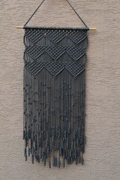 Wall panels handmade macramé technique. Material: 100% polyester. Color: grey Strap: natural wood - pine. Dimensions: The length of the strap to the bottom, including the thread - 83cm / 32,7 inches Width of macrame - 36cm / 14,2 inches