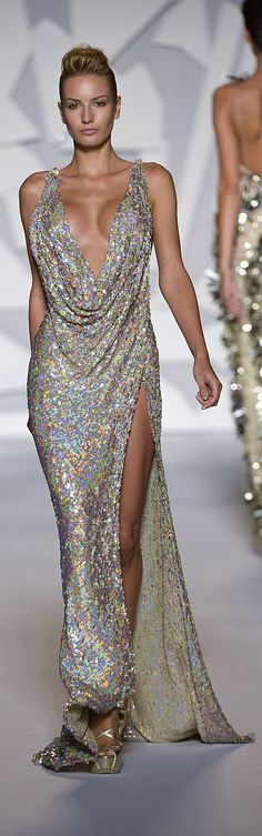 Abed Mahfouz - Couture - Fall-Winter 2012-2013 http://en.flip-zone.com/fashion/couture-1/independant-designers-41/abed-mahfouz-2330