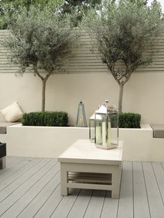 high walled courtyard patio grey paving raised bed - Google Search