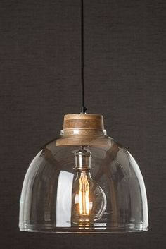glass cloche and wooden pendant light at