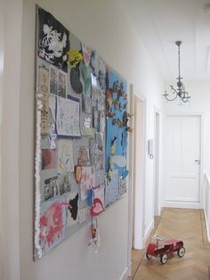Oversized bulletin board for displaying the kids' artwork! I would probably tie it to the decorating scheme of the room via painting or covering with fabric.