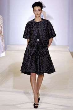 """1950's silhouettes - dresses with tiny waists and full skirts, stand-collar coats and jackets with bracelet-length sleeves."" Temperley London Spring 2013 RTW"