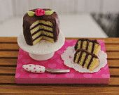 Miniature Layer Cake With Creamy Chocolate Icing And A Hot Pink Rose