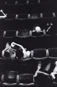 I adore this photo. The empty spaces and mix of ages suggest an art house film. These people are watching a good movie.