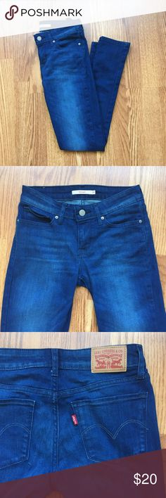 """Levi's '711' skinny jean in dark wash Only worn once, great condition!  Mid-rise fit with 29"""" inseam. Nice, thick, stretchy dark wash denim with a slim ankle. Levi's Jeans"""