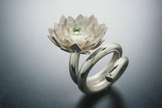 "Ring | Aline Kokinopoulos. ""Lotus"" Sterling silver and peridot."
