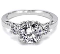 I started ring shopping thinking I'd hate round stones, but there are SO many more settings available for rounds. This one's not too shabby.