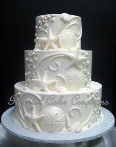 https://flic.kr/p/x4K7a7   Elegant Beach Themed White Butter Cream Wedding Cake with Shells, Scrolls and Beads