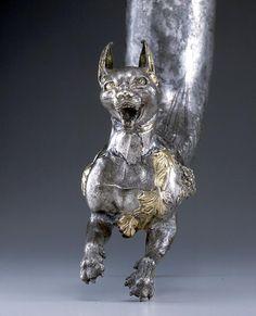 http://www.cais-soas.com/CAIS/Images2/Parthian/Artefacts/Parthian_Silver_Gilded_Lynx_Rhyton_