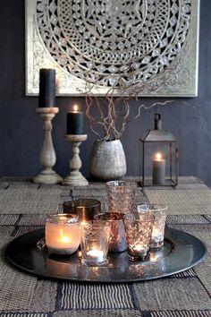 Un rincon con velas para el exterior. Linda combinacion negro/gris/plata