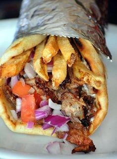 gyros and other Greek specialties in Norwood The Feisty Greek gyro includes crisp french fries.The Feisty Greek gyro includes crisp french fries. Greek Recipes, Italian Recipes, Receta Bbq, Healthy Dinner Recipes, Cooking Recipes, Lamb Recipes, Greek Gyros, Sandwich Toaster, Tandoori Masala