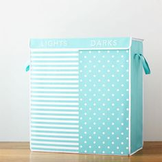 $89 BUY NOW You didn't spend 40 weeks carefully curating your baby's wardrobe only to have it ruined by a laundry mix-up. This dual compartment hamper makes it so easy to separate whites from colors, even your husband can do it!