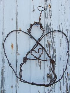 Rustic Barbed Wire Angel; so  simple but cute.