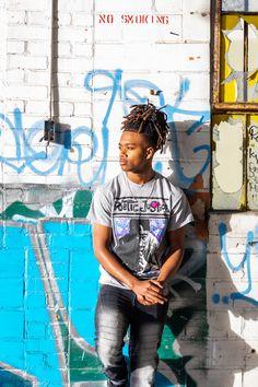 2020 male senior portraits pose urban graffiti Dreads Lorinda K.