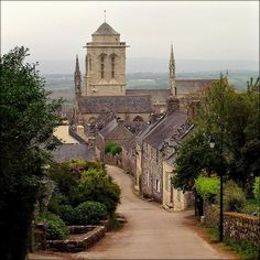 Locronan, Bretagne, France, main steet of town, with cathedral