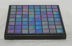 Iridized blue glass mosaic trivet. $25.00, via Etsy.
