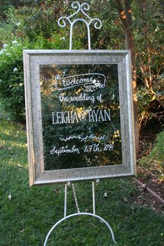Wedding welcome on silver leaf mirror. Banner and leaf garland detail inspired by wedding invitation