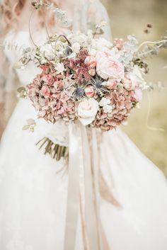 Stunning wedding bouquet fit for a country wedding. Photography by Naomi Kenton.