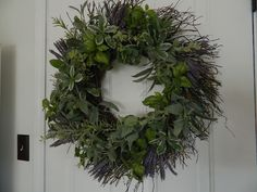 ...basil, rosemary and thyme wreath.  Can use each of these independently to make a wreath or all together as in this beautiful and practical wreath shown.