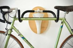 A simple bike rack can help you clear up that jumble of two-wheelers in your garage—or around your yard. Here are five DIY bike racks you could make in a weekend. Diy Bike Rack, Bike Hanger, Bicycle Storage, Bicycle Rack, Bicycle Parts, Crochet Velo, Rack Solutions, Bike Repair Stand, Range Velo