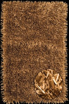 the metallic gold shimmer from this spectacular area rug catches the light with luminescent satin ribbons