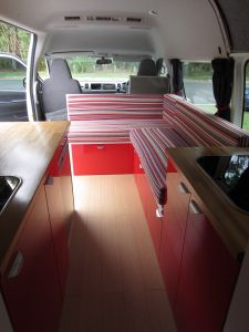 Building a DIY camper van by TheCamperVanConverts. [really inspirational and sharp-looking camper van. Includes great tutorials for sewing cushion covers, an awesome convertible lounge/bed, and nice pics of their plumbing set-up + more]