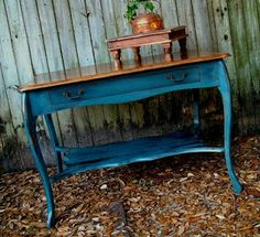Annie Sloan Aubusson Blue with a base of Graphite she then distressed and finished with the dark wax.