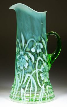 DAFFODIL TANKARD WATER PITCHER, green opalescent, applied handle. H Northwood Co. Circa 1903.