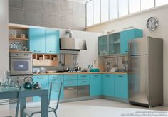 #Kitchen Idea of the Day: A modern Italian kitchen with teal blue cabinets and stainless steel appliances. By Latini Cucine.