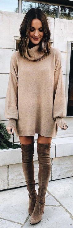 Beige oversized knit dress with brown OTK boots.