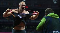 Robert Harting of Germany celebrates winning gold in the men's Discus Throw final on Day 11 of the London 2012 Olympic Games at Olympic Stadium.